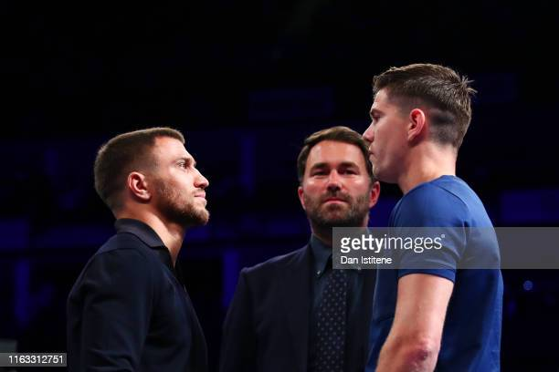 Boxing promoter Eddie Hearn looks on as Vasyl Lomachenko and Luke Campbell face off in the ring ahead of the WBC Interim Title and Final Eliminator...