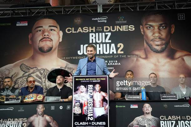Boxing promoter Eddie Hearn speaks as Heavyweight Boxing Champion Andy Ruiz Jr and contender Anthony Joshua looks on at a press conference for Ruiz...