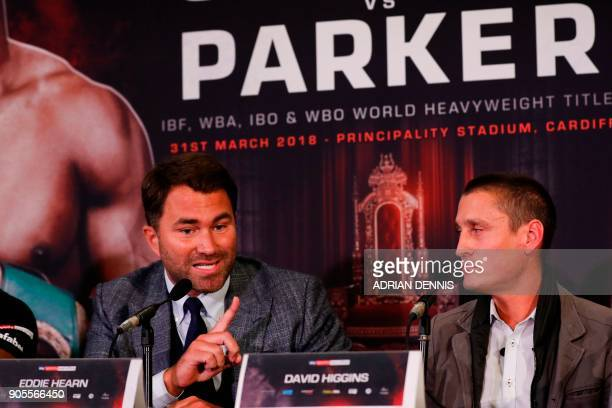 Boxing promoter Eddie Hearn speaks as promoter David Higgins listens at a press conference in central London on January 16 2018 to promote the March...