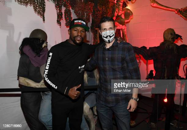 Boxing promoter Floyd Mayweather Jr. And Fright Ride creator Jason Egan pose with zombie props after Mayweather went through the Fright Ride...
