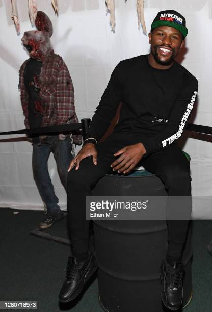 Boxing promoter Floyd Mayweather Jr. Poses with a prop zombie after going through the Fright Ride immersive haunted attraction on October 17, 2020 in...