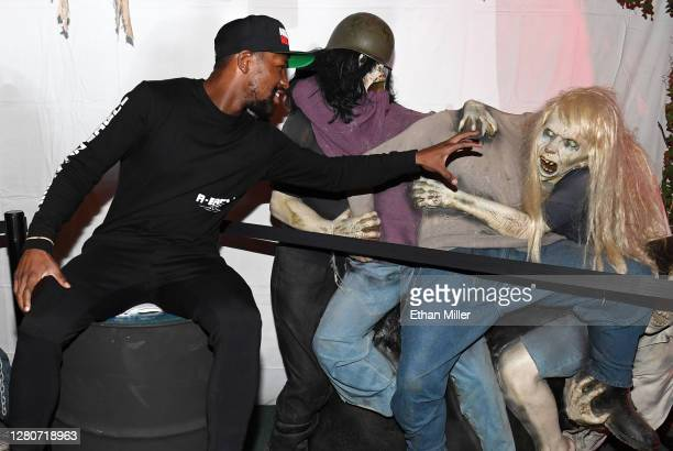 Boxing promoter Floyd Mayweather Jr. Poses with prop zombies after going through the Fright Ride immersive haunted attraction on October 17, 2020 in...