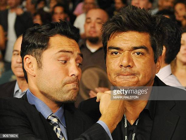 Boxing promoter Oscar de la Hoya and comedian George Lopez pose for photos before the Juan Manuel Marquez of Mexico and Floyd Mayweather Jnr. Of the...