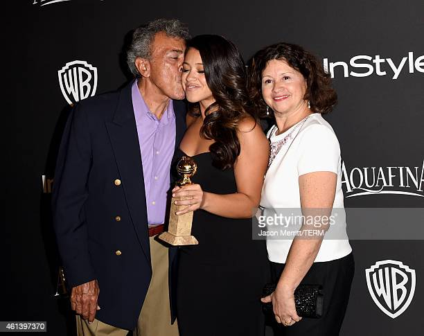 Boxing referee Genaro Rodriguez actress Gina Rodriguez and Magali Rodriguez attend the 2015 InStyle And Warner Bros 72nd Annual Golden Globe Awards...