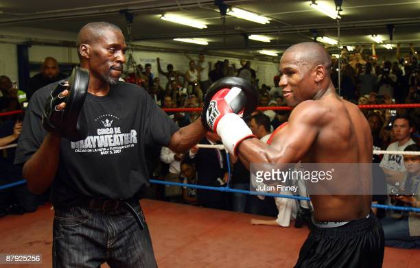 Boxing superstar Floyd Mayweather in his first open workout since coming out of retirement with trainer and uncle Roger Mayweather as he prepares for...