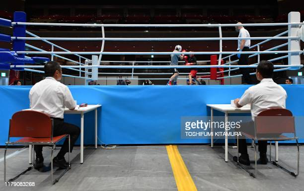 Boxing Task Force officials demonstrate a new judge monitoring system during a boxing test event at the Kokugikan Arena, a venue for the Tokyo 2020...