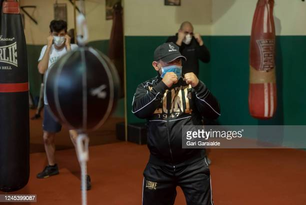 Boxing trainer and former professional boxer Latigo Sr gives instructions to his pupils during a training session at the Team Latigo Boxing Club on...