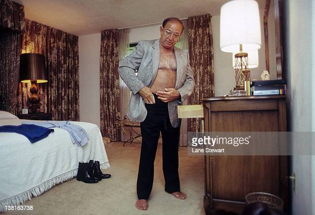 Trainer Angelo Dundee getting dressed in his home Clearwater FL CREDIT Lane Stewart