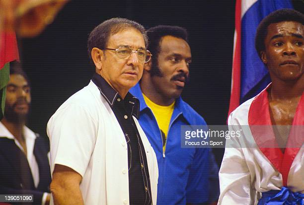 Boxing trainer Angelo Dundee left looks on before the start of a welterweight fight involving Sugar Ray Leonard right circa 1977