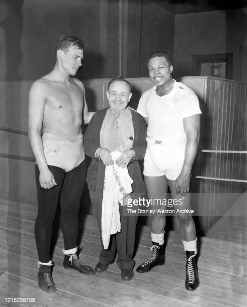Boxing trainer Charley Goldman poses with professional boxers Cesar Brion of Argentina and Archie Moore of the United States circa 1955 at Stillman's...