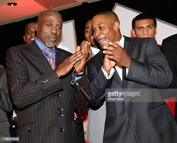 Boxing trainer Roger Mayweather and DeJuan Blake applaud as boxer Floyd Mayweather Jr accepts the award for Male Fighter of the Year from Nevada at...