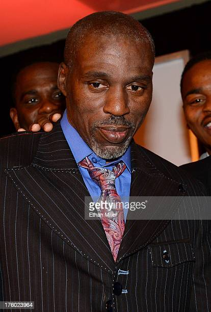 Boxing trainer Roger Mayweather stands onstage as boxer Floyd Mayweather Jr accepts the award for Male Fighter of the Year from Nevada at the Nevada...
