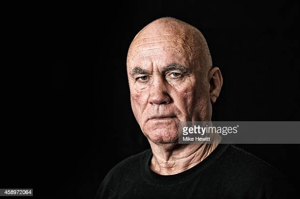 Boxing trainer Ronnie Davies poses for a portrait during a training session at the Brighton and Hove Boxing Club on November 14 2014 in Brighton...