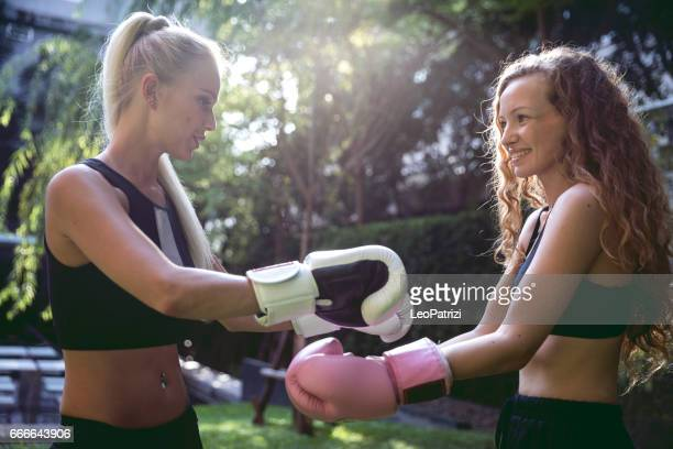 Boxing training outdoor - Sport Concepts - Two women friends working out