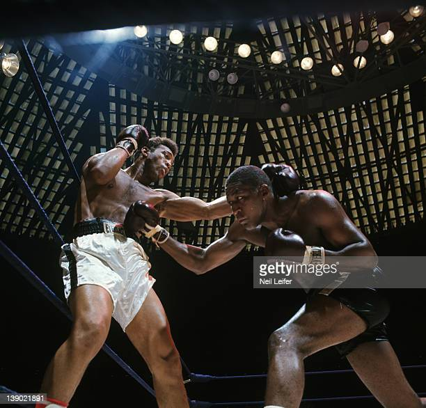 WBA Heavyweight Elimination Tournament Jimmy Ellis in action taking punch vs Leotis Martin during fight at Astrodome The bouts determined the new...