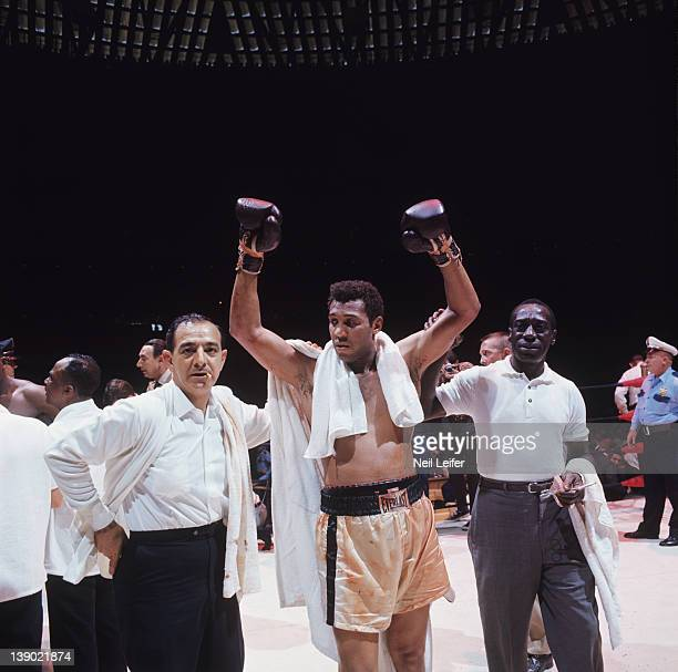 Heavyweight Elimination Tournament: Jimmy Ellis victorious with trainer Angelo Dundee and assistant trainer Wali Muhammad after winning fight vs...
