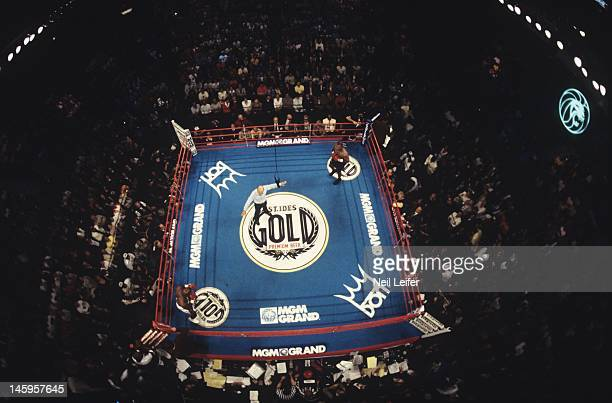 WBA Heavyweight Title Aerial view of referee Mills Lane in center of ring during Evander Holyfield vs Mike Tyson fight at MGM Grand Garden Arena Las...