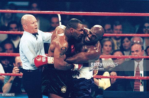 Boxing WBA Heavyweight Title Mike Tyson in action biting Evander Holyfield's ear during match at MGM Grand Las Vegas NV 6/28/1997