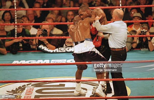 Boxing: WBA Heavyweight Title, Mike Tyson in action, biting off ear of Evander Holyfield during match at MGM Grand, Las Vegas, NV 6/28/1997