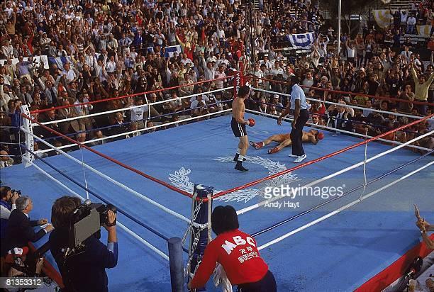 Boxing WBA Lightweight Title Deuk Koo Kim on canvas after knockout vs Ray Boom Boom Mancini at Caesars Palace View of referee Richard Greene Kim died...