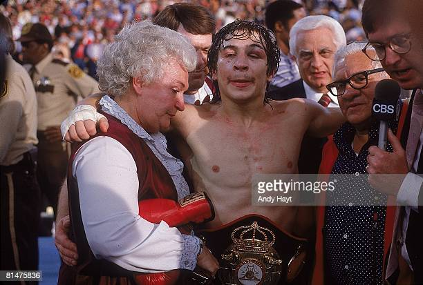 Boxing WBA Lightweight Title Ray Boom Boom Mancini victorious wearing trophy belt with mother and father during CBS Sports media interview after...