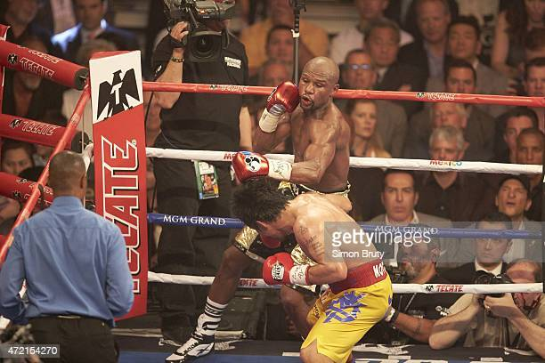 WBA Super World / WBC / WBO Welterweight Title Floyd Mayweather in action vs Manny Pacquiao during fight at MGM Grand Garden Arena Las Vegas NV...