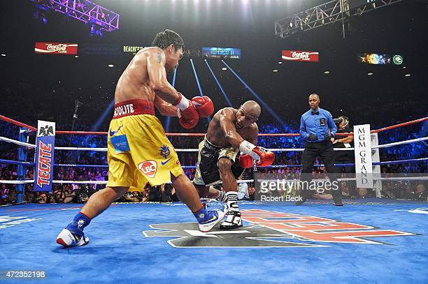 WBA Super World/ WBC/ WBO Welterweight Title Floyd Mayweather in action vs Manny Pacquiao during fight at MGM Grand Garden Arena View of referee...