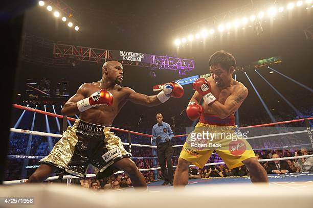 WBA Super World/ WBC/ WBO Welterweight Title Floyd Mayweather in action vs Manny Pacquiao during fight at MGM Grand Garden Arena Las Vegas NV CREDIT...