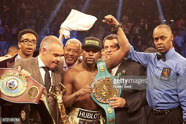 WBA Super World / WBC / WBO Welterweight Title Floyd Mayweather victorious with belts in ring after winning unified title bout vs Manny Pacquiao at...