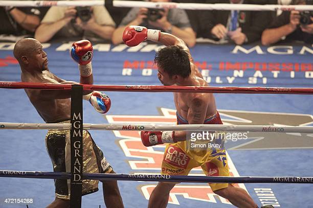 WBA Super World / WBC / WBO Welterweight Title Manny Pacquiao in action vs Floyd Mayweather during fight at MGM Grand Garden Arena Las Vegas NV...
