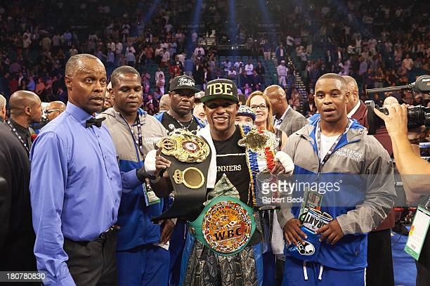 WBA/ WBC Light Middleweight Title Floyd Mayweather Jr in ring with title belts before bout vs Canelo Alvarez at MGM Grand Garden Arena Las Vegas NV...