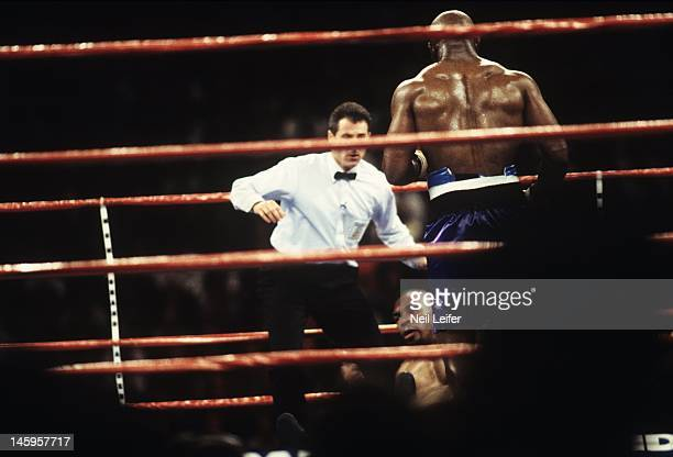 WBA World Heavyweight Title Mike Tyson during knockdown by Evander Holyfield at MGM Grand Garden Arena View of referee Mitch Halpern Las Vegas NV...