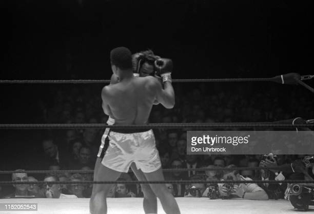 WBA World Heavyweight Title Muhammad Ali in action vs Cleveland Williams at Astrodome View of SI photographer Neil Leifer in frame with camera...