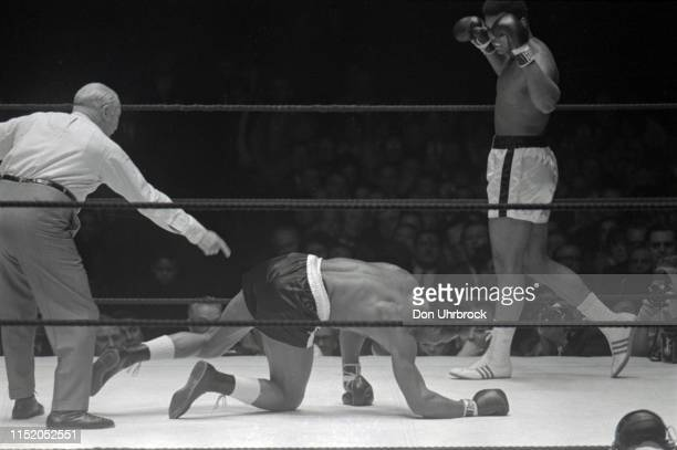 WBA World Heavyweight Title Muhammad Ali victorious after nockdown vs Cleveland Williams getting up from canvas at Astrodome View of SI photographer...