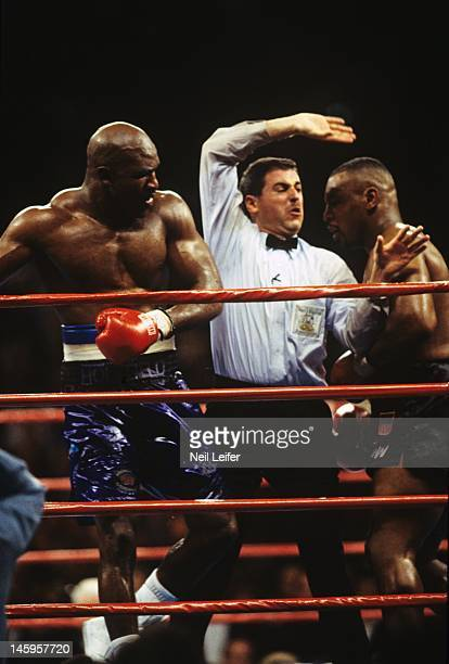 WBA World Heavyweight Title View of referee Mitch Halpern in between Evander Holyfield and Mike Tyson during fight at MGM Grand Garden Arena Las...