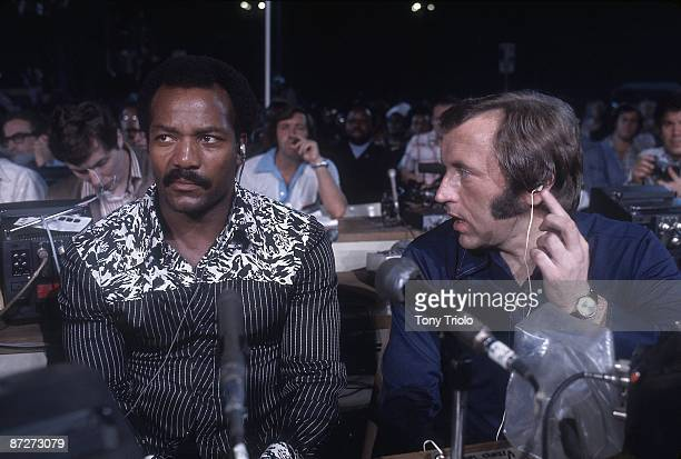 WBA/WBC Heavyweight Title View of former football player Jim Brown and English broadcaster David Frost watching Muhammad Ali vs George Foreman fight...
