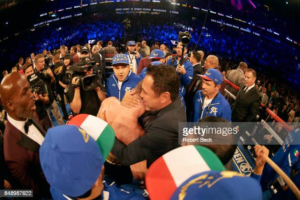 WBA/WBC/IBF/IBO Middleweight Title Canelo Alvarez hugging promoter Oscar De La Hoya after fight vs Gennady Golovkin at TMobile Arena Las Vegas NV...