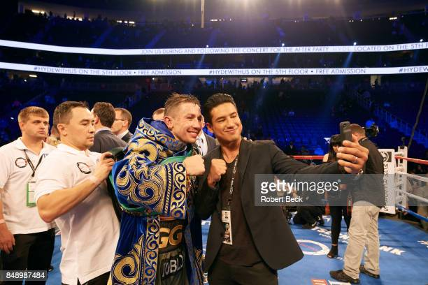 WBA/WBC/IBF/IBO Middleweight Title Gennady Golovkin wearing WBC belt and posing for selfie with Extra host Mario Lopez in right after fight vs Canelo...
