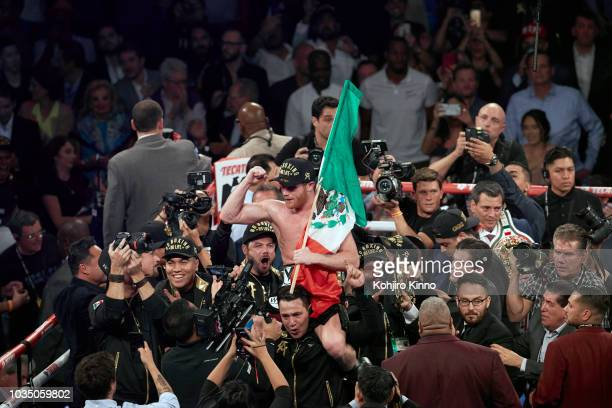 WBA/WBC/IBO World Middleweight Title Canelo Alvarez victorious in ring with national flag of Mexico after winning fight vs Gennady Golovkin at...