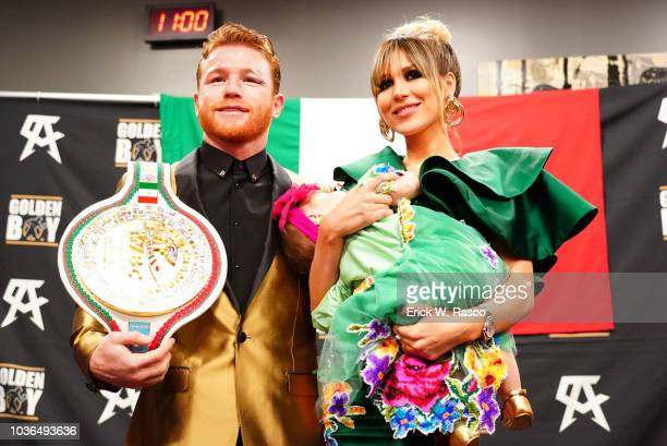 WBA/WBC/IBO World Middleweight Title Canelo Alvarez with title belt and girlfriend Fernanda Gomez and daughter Maria Fernanda after fight vs Gennady...
