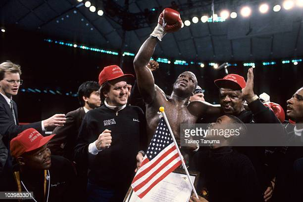 WBC Heavyweight Title James Buster Douglas victorious with son Lamar after winning fight vs Mike Tyson at Tokyo Dome Tokyo Japan 2/11/1990 CREDIT...