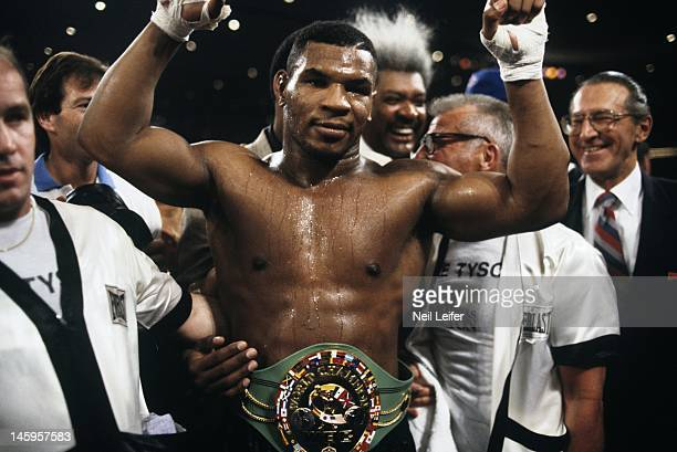 WBC Heavyweight Title Mike Tyson victorious with trophy belt after winning fight vs Trevor Berbick with round 2 TKO at Hilton Hotel Las Vegas NV...