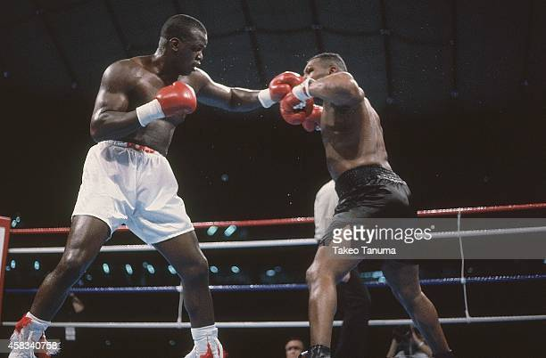 WBC/ WBA/ IBF Heavyweight Title James Buster Douglas in action throwing punch vs Mike Tyson at Tokyo DomeTyson is defeated by Douglas by 10th round...