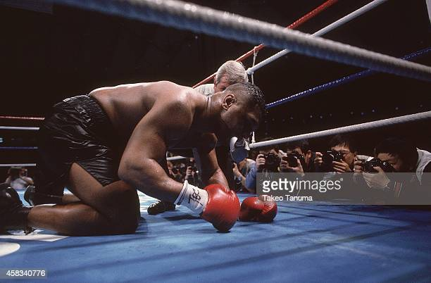 WBC/ WBA/ IBF Heavyweight Title Mike Tyson down on canvas during bout vs James Buster Douglas at Tokyo DomeTyson is defeated by Douglas by 10th round...