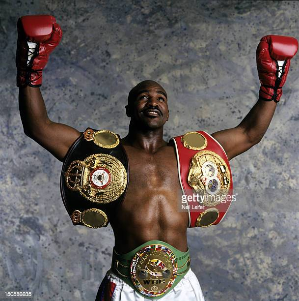 WBC/ WBA/ IBF Heavyweight Title Preview Portrait of Evander Holyfield wearing trophy belts during photo shoot at Madison Square Garden New York NY...