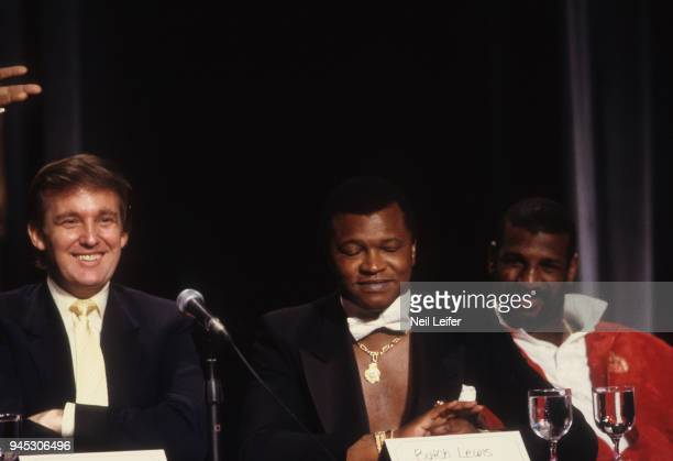 WBC/ WBA/ IBF Heavyweight Title Preview View of celebrity businessman Donald Trump promoter Butch Lewis and Michael Spinks on podium during media...