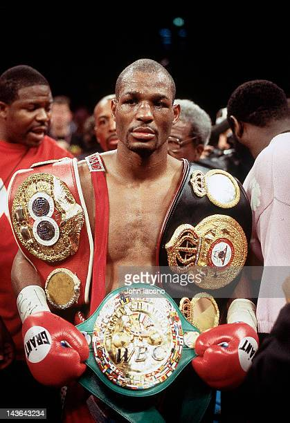 WBC/ WBA/ IBF Middleweight Title Bernard Hopkins victorious with trophy belts after winning fight vs Felix Trinidad at Madison Square Garden New York...
