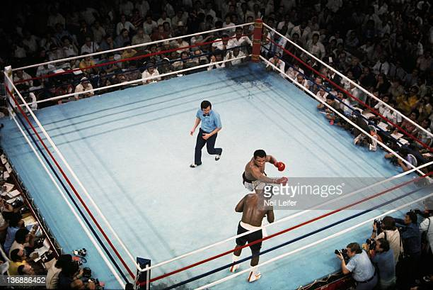 Boxing WBC/ WBA World Heavyweight Title Aerial view of Muhammad Ali in action right hook punch vs Joe Frazier during fight at Araneta Coliseum View...