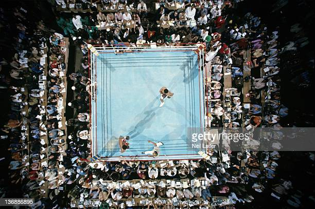 Boxing WBC/ WBA World Heavyweight Title Aerial view of Muhammad Ali and George Foreman in ring after bell during round 1 of fight at Stade du 20 Mai...