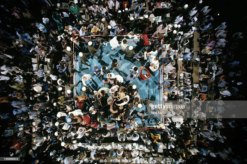WBC/ WBA World Heavyweight Title: Aerial view of Muhammad Ali victorious with cornermen as fans and soldiers rush the ring after round 8 knockout of George Foreman at Stade du 20 Mai. Kinshasa, Zaire
